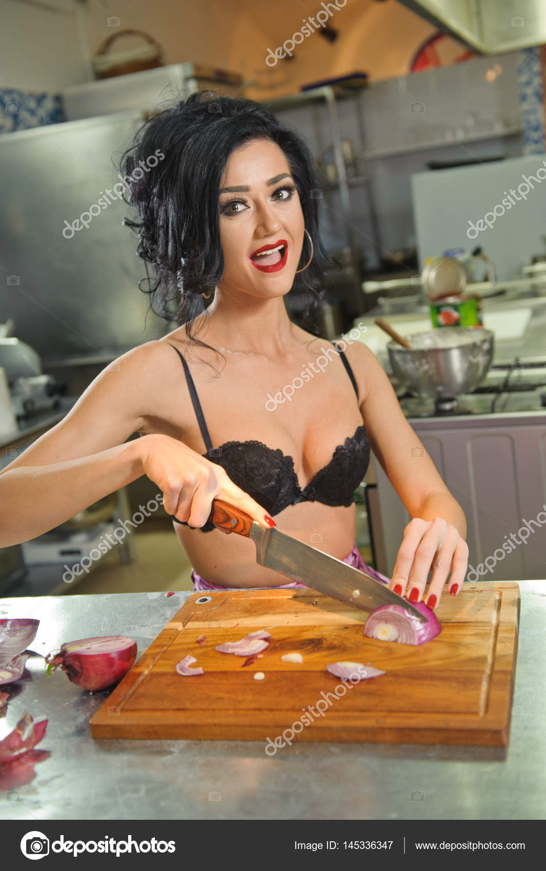 eec5cb2b2d6aa Beautiful and sexy woman in the kitchen. Smiling brunette preparing food. Young  girl wearing black bra ...