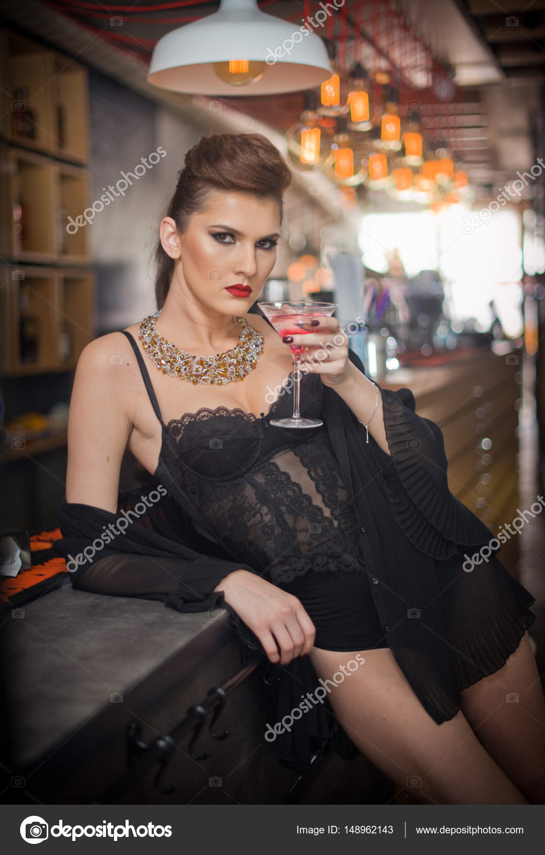 Handsome girl wearing beautiful body and high heels in indoor scene.Fashion  model with long sexy legs drink ...