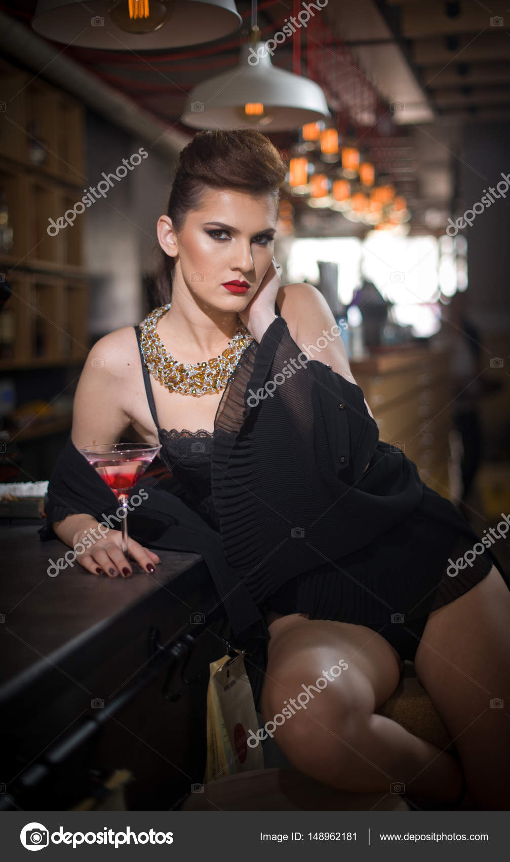 Sensual girl with long legs and high heels sitting on the chair in bar drinking .Handsome girl wearing beautiful body and high heels in indoor scene.  sc 1 st  Depositphotos & Sensual girl with long legs and high heels sitting on the chair in ...