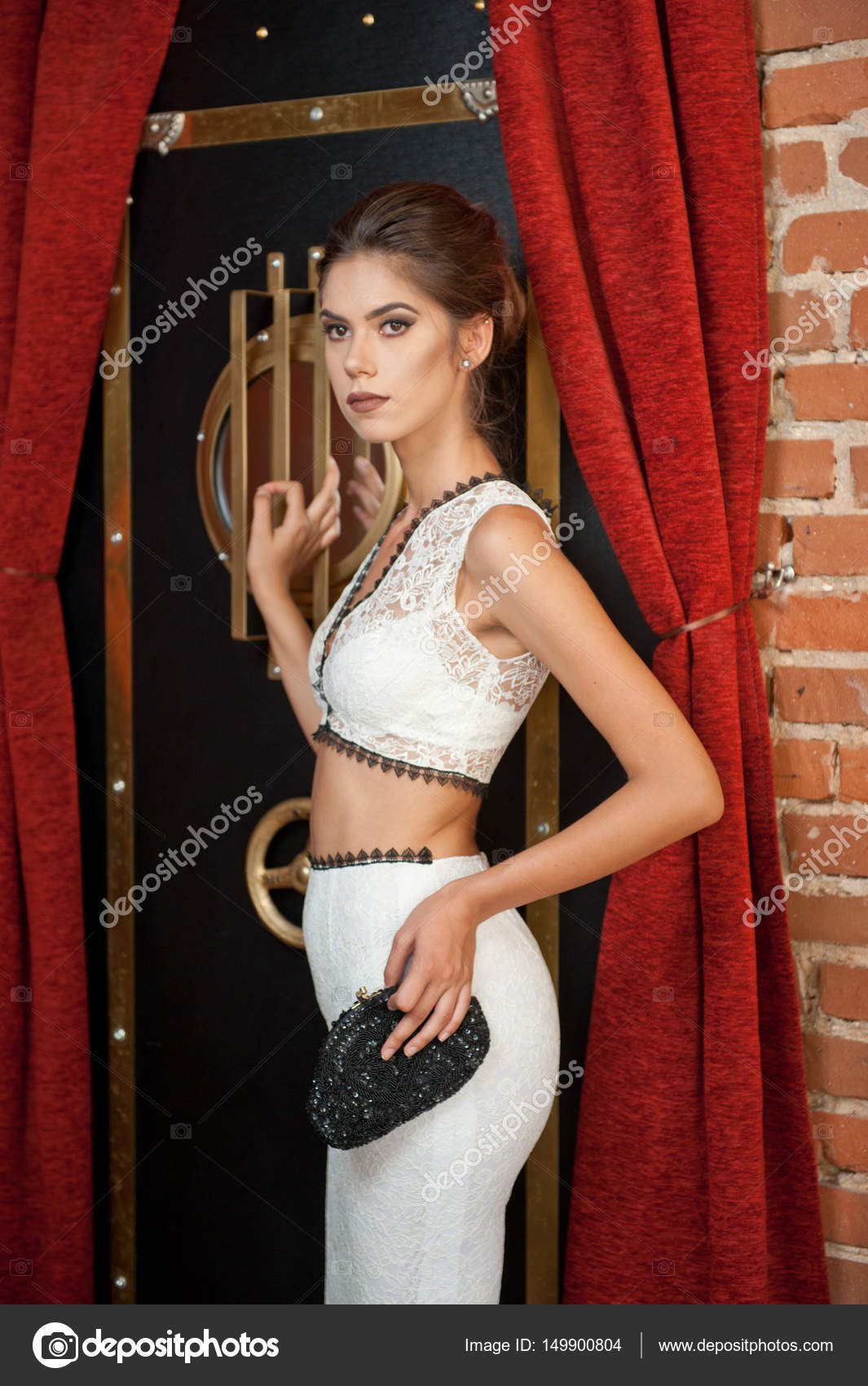 Fashionable Sensual Attractive Lady With White Dress Standing Near A
