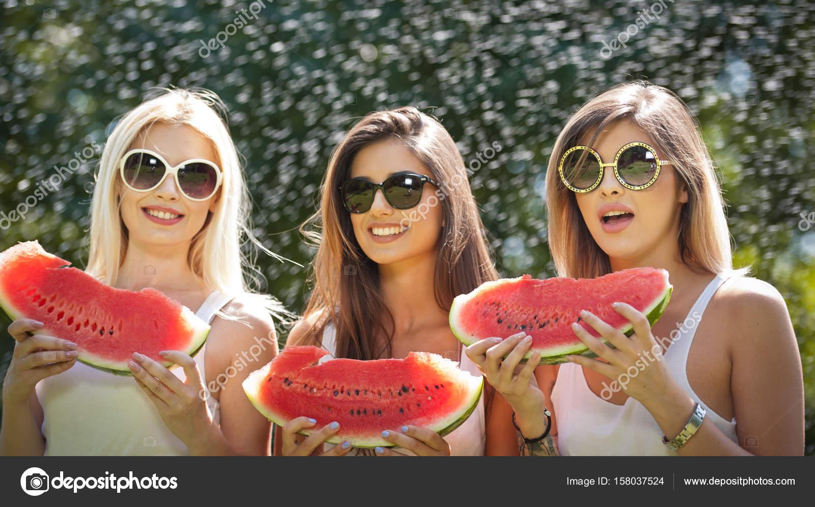 Beautiful Girls With Sunglasses Eating Fresh Watermelon