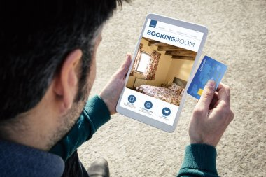 booking a room online tablet credit card