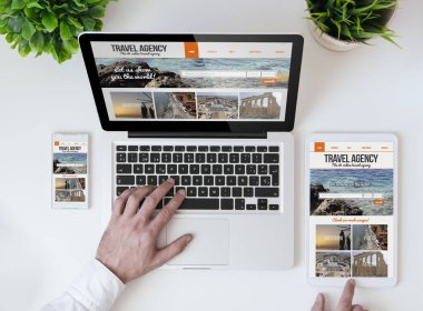 laptop showing travel agency online website
