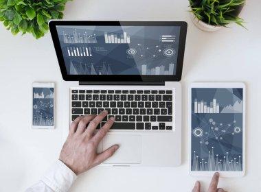 laptop showing finances.
