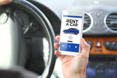 Fotografie  smartphone with rent a car website