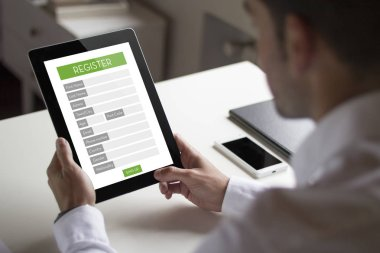 Businessman registering on web with tablet pc