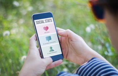 woman checking social stats
