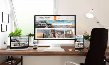 3d rendering of computer, laptop, tablet pc and smartphone showing travel agency website