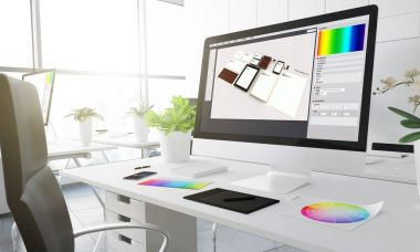 graphic design  on computer screen, creative studio workplace with colour swatches on the table, 3d rendering