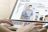 Photo man doing shopping online using laptop