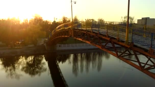 Bridge over the river sunset sunset video from a drone, 4k video
