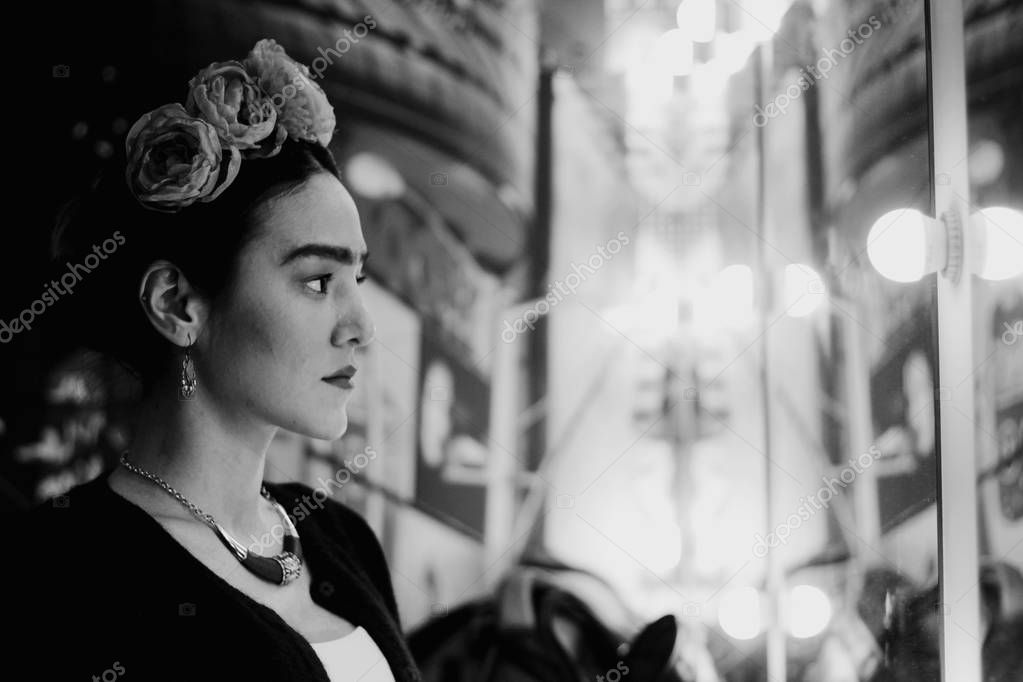 Image of a Mexican artist Frida Kahlo in a modern performance