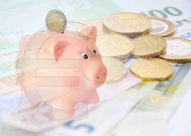 piggy bank with euro symbol and euro background