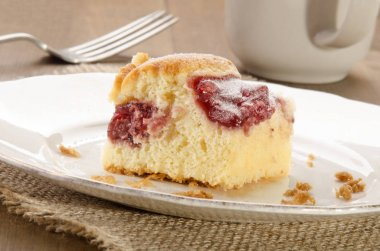 Home Baked Cake With Strawberry Filling And Powdered Sugar