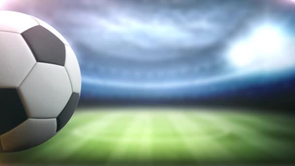 fotbalový míč otáčí proti stadionu pozadí na levé straně s prostorem pro název, logo nebo skóre na pozadí 4k Ultra Hd.