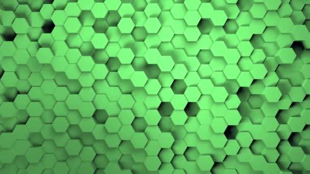 Abstraktní šestiúhelníkové pozadí geometrie. Světle zelený šestihranný vzor mřížky s vlnícím se plátnem na pozadí. 3D vykreslování mozaiky tapety se šesti úhly postavy. Tmavá bezešvá smyčka 4k video.