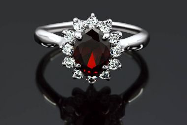 Jewelry made of gold and silver with precious stones on a black background in high quality and resolution