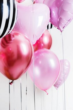 Set of balloons in the form of a heart and round pink and striped on light background with copy space. stock vector