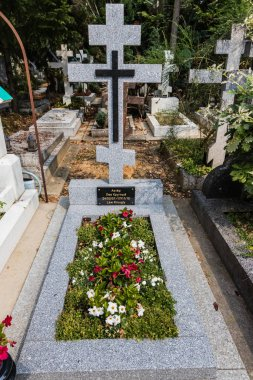 A grave tomb of Lev Krugly, a Soviet and French actor, in the Russian Orthodox Cemetery off Sainte-Genevieve-des-Bois, France