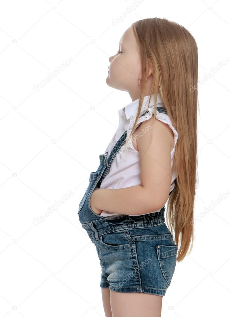 Cicciona Lato Allontanò Lunghi Fotocamera Ragazza La Biondi Capelli E  Bambina Jeans Offesa Con Si Salopette Di ... 7c3e37e982f