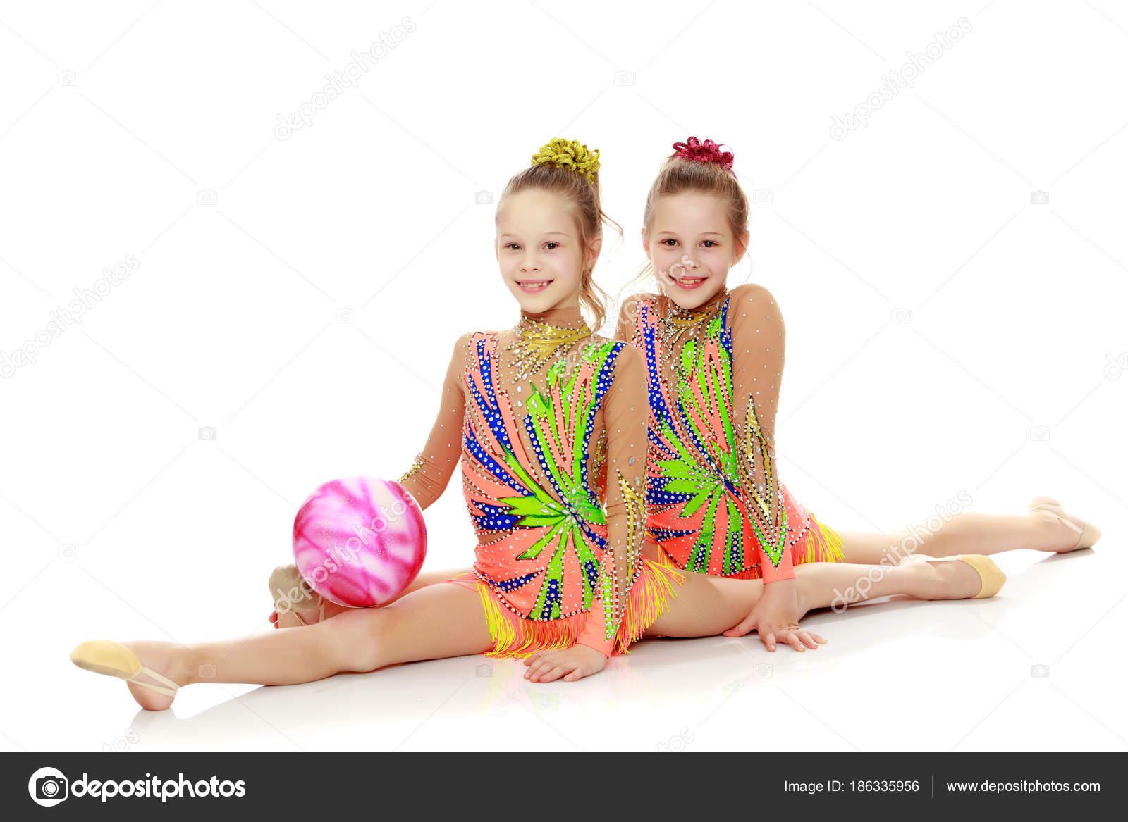 93836c4f2 Two girls gymnast sitting on splits. — Stock Photo © lotosfoto1 ...