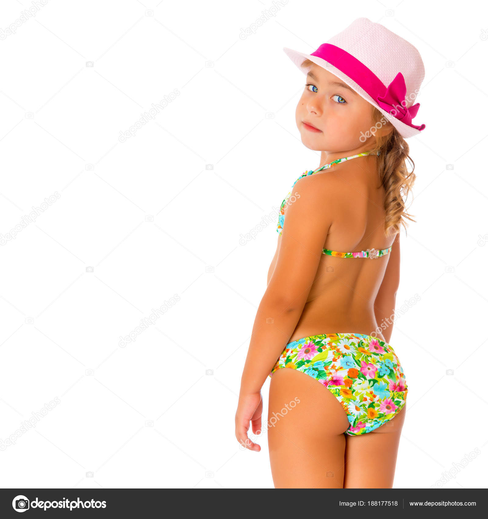 5e5ebd40b6f7 Beautiful little tanned girl in a swimsuit and a hat. The concept of summer  family vacations, rest on the sea, beautiful tan. Isolated on white  background.