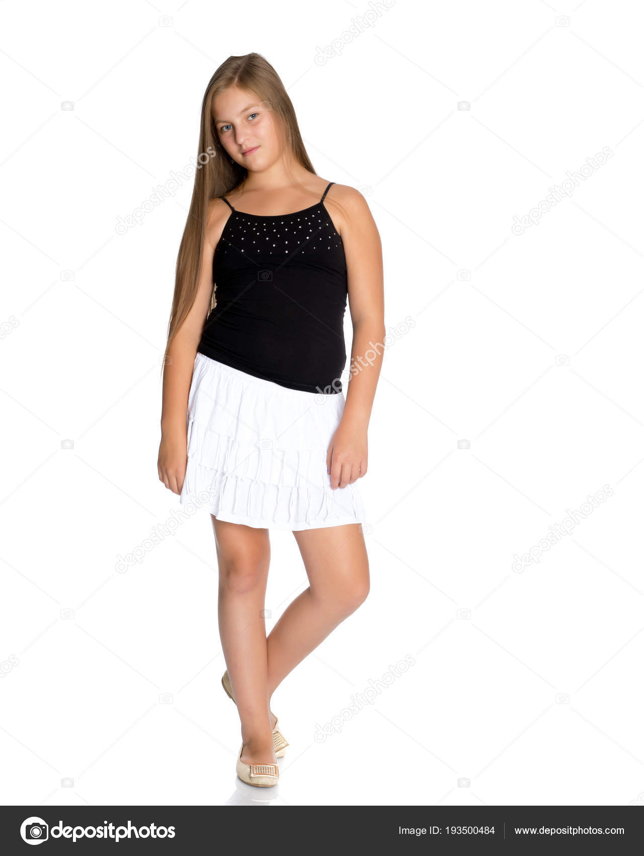 50a137e6da A teenage girl in a short white skirt and a black T-shirt.– stock image
