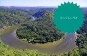 Fotografie Saarschleife of the Saar near Orscholz with the word in green Saarland, with a view of the entire Saarbiegung in Saar-Lor-Lux Saarland Germany Europe