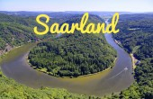 Fotografie Saarschleife of the Saar near Orscholz with the word in yellow Saarland, with a view of the entire Saarbiegung in Saar-Lor-Lux Saarland Germany Europe