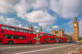 Photo London with red buses against Big Ben in England, UK
