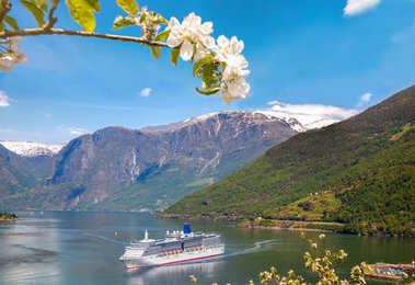 Cruise ship in fjord during spring time, Flam, Norway
