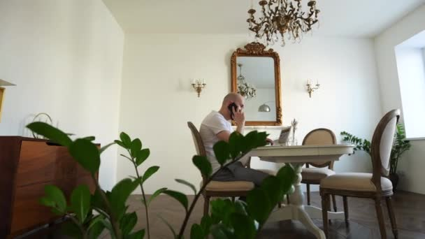 Self-isolation during quarantine, a man works at home at a computer