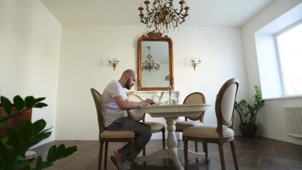 Stay at home. Self-isolation during quarantine, a man works at home at a computer. Modern interior