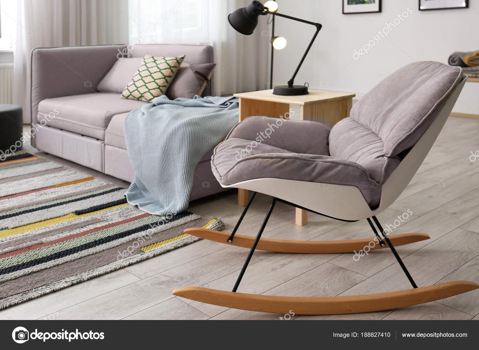 Stylish Living Room Interior With Rocking Chair And Comfortable Sofa Stock Photo C Liudmilachernetska Gmail Com 188827410