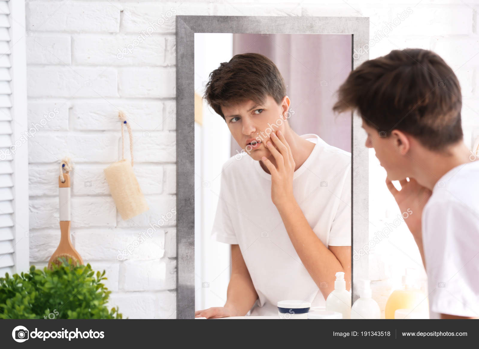 teenage boy with acne problem looking in mirror at home u2014 stock photo o80 mirror
