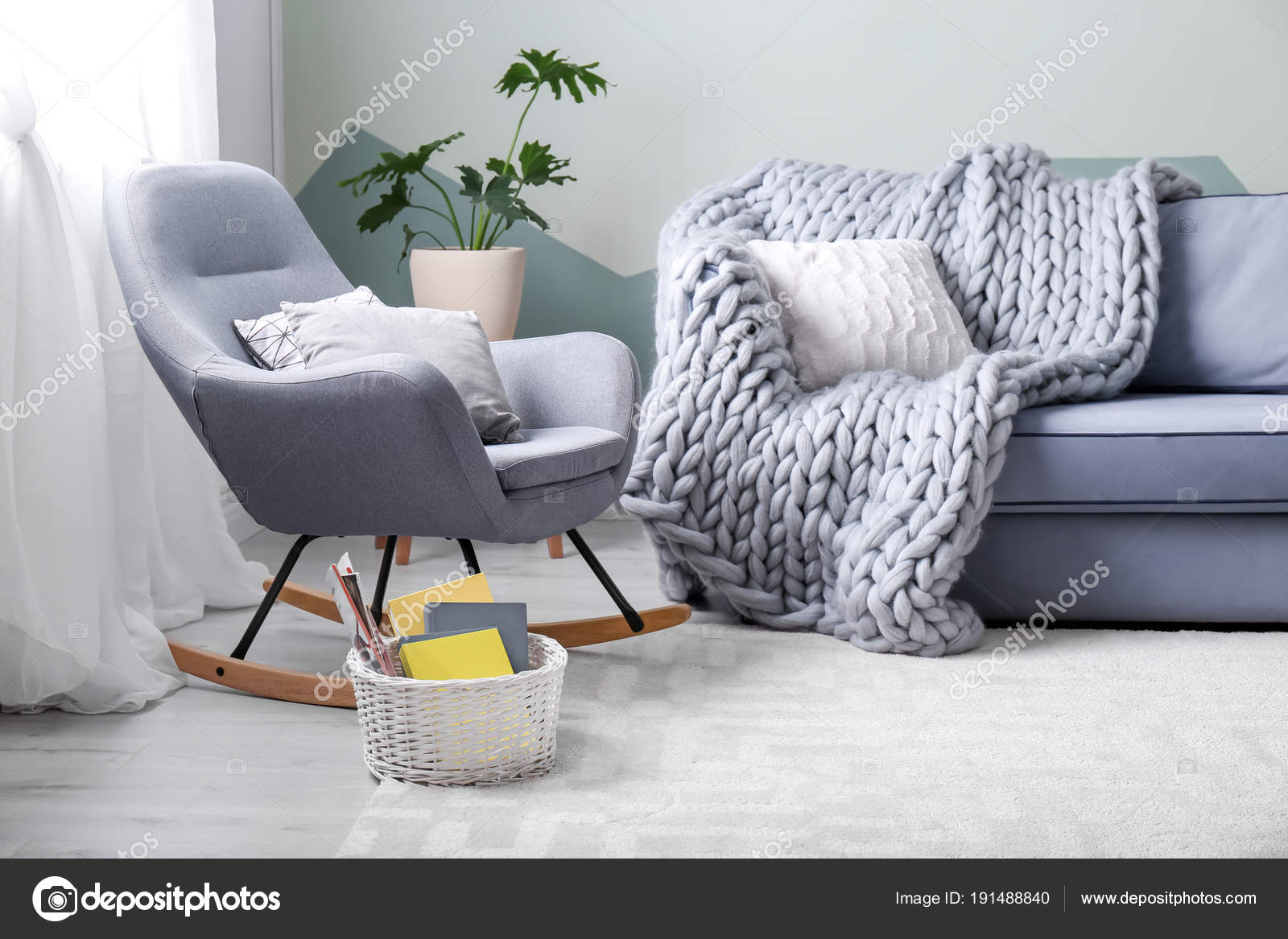 Stylish Living Room Interior With Comfortable Sofa And Rocking Chair