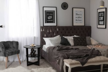Stylish room interior with comfortable bed