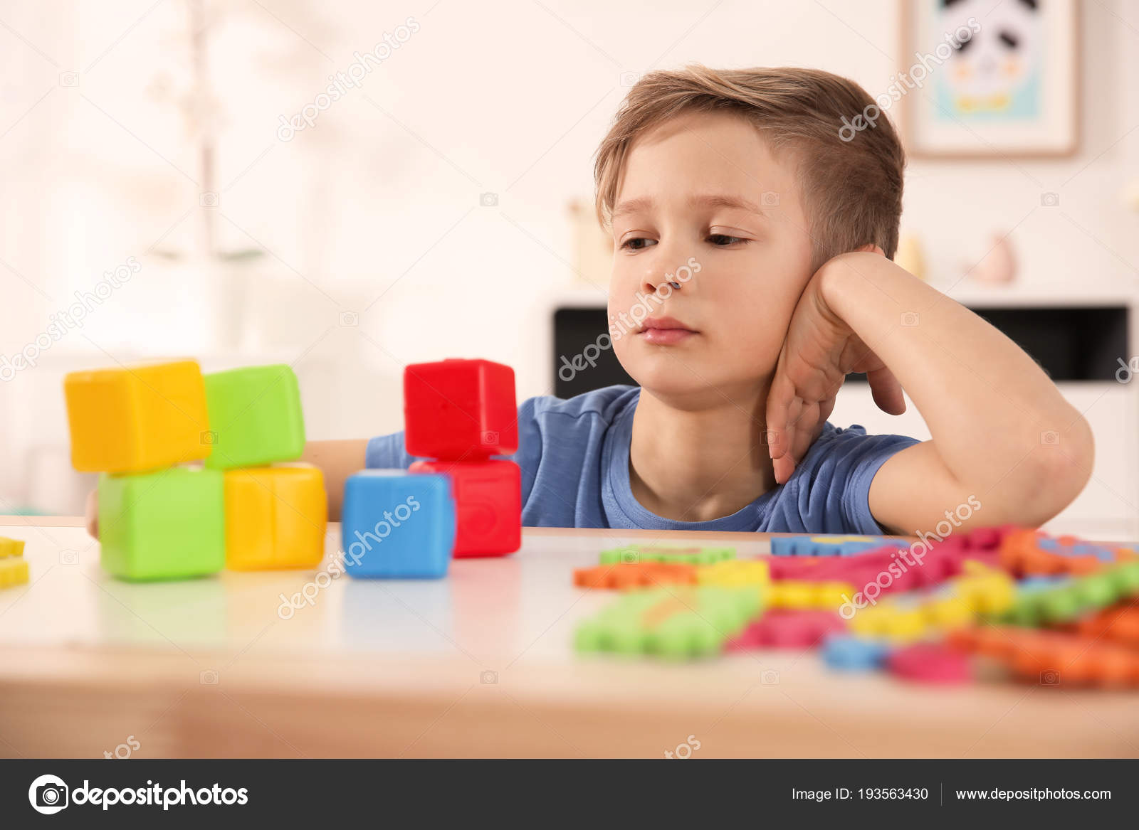 Learning Toys For Autistic Toddlers : Little autistic boy playing with cubes at home u stock photo
