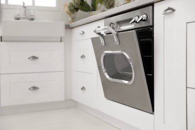 New modern oven in stylish kitchen. Cooking appliance