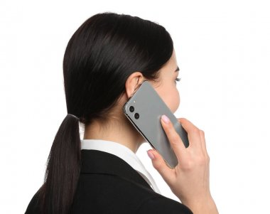 Young businesswoman talking on mobile phone against white background
