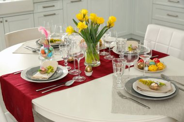 Festive Easter table setting with floral decor in kitchen
