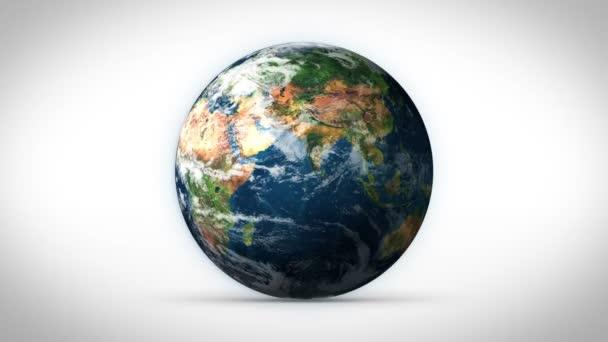 planeta Země točí s bílým pozadím