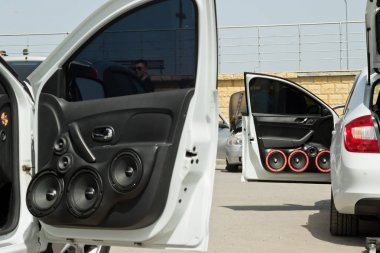 car with a large number of installed audio speakers and subwoofe