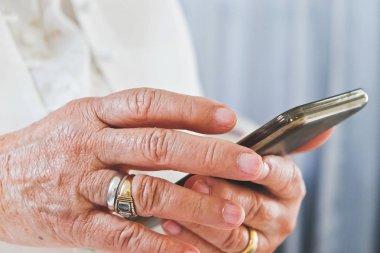 Senior woman using her mobile phone