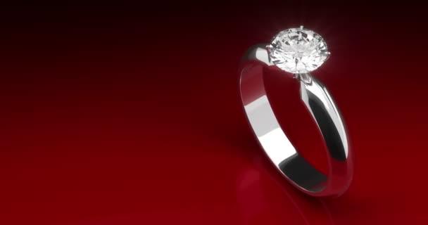 Diamant-Ring auf rotem Hintergrund