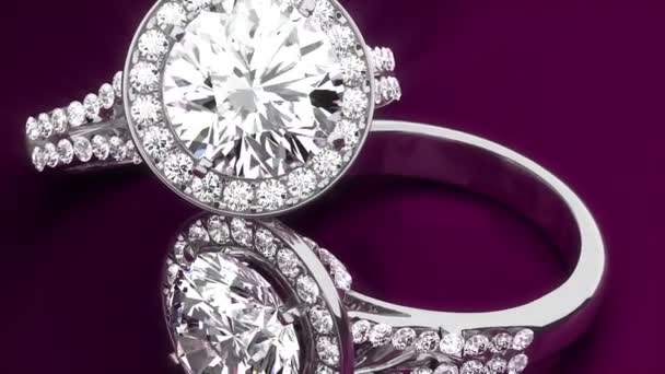 Diamantové prsteny na fialovém pozadí