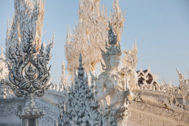 beautiful decorative statues and sculptures on Wat Rong Khun White Temple, Chiang Rai, Thailand