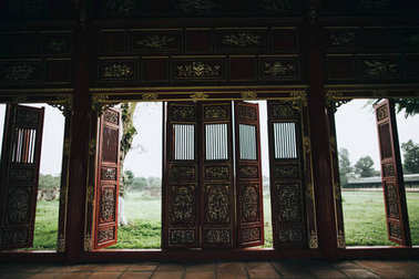 Decorative doors in traditional oriental building, Hue, Vietnam stock vector