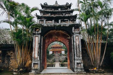 Entrance to the beautiful oriental park with traditional ancient architecture in Hue, Vietnam stock vector