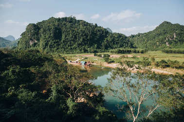 Beautiful landscape with river and mountains in Phong Nha Ke Bang National Park, Vietnam stock vector